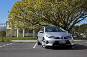 Corolla Hatch GX in Silver Pearl - by tree front